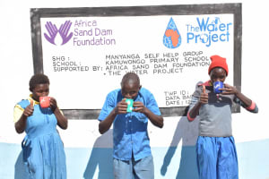 The Water Project: Kamuwongo Primary School -  Drinking Water From The Tank