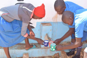 The Water Project: Kamuwongo Primary School -  Filling Up Cups At The Tank