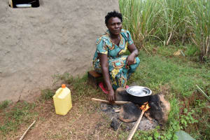 The Water Project: Nangurunya Community, Robert Musali Spring -  Madam Agnes Cooking Vegetables Outside Her House