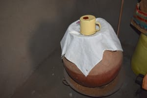 The Water Project: Nangurunya Community, Robert Musali Spring -  Water Storage Pot Covered With Cloth And Cup Used For Drawing Water