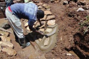 The Water Project: Shamoni Community, Shatuma Spring -  Stone Pitching