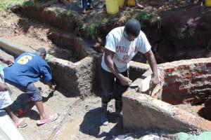 The Water Project: Shamoni Community, Shatuma Spring -  Plastering The Walls