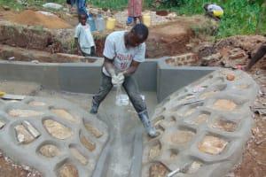 The Water Project: Shamoni Community, Shatuma Spring -  Floor Plastering