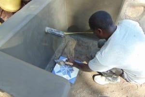 The Water Project: Shamoni Community, Shatuma Spring -  Tile Setting