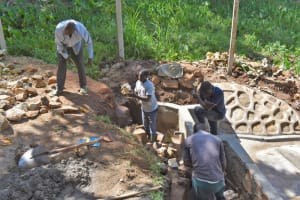 The Water Project: Shamoni Community, Shatuma Spring -  Backfilling With Rocks