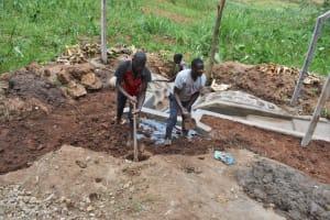 The Water Project: Shamoni Community, Shatuma Spring -  Backfilling With Soil