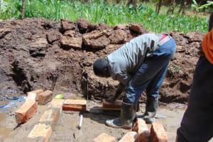 The Water Project: Shamoni Community, Shatuma Spring -  Brick Setting