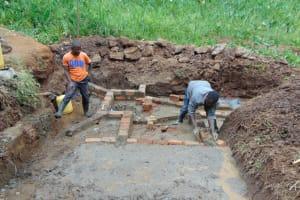 The Water Project: Shamoni Community, Shatuma Spring -  Wall Construction