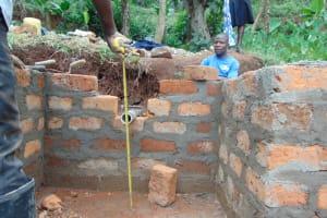 The Water Project: Shamoni Community, Shatuma Spring -  Pipe Measurement And Setting