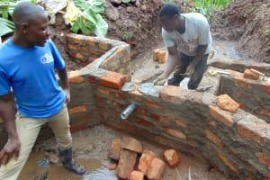 The Water Project: Shamoni Community, Shatuma Spring -  Pipe Setting