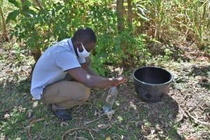 The Water Project: Shamoni Community, Shatuma Spring -  Demonstration On How To Make A Leaky Tin