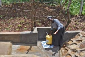 The Water Project: Shamoni Community, Shatuma Spring -  Fetching Water From Shatuma Sping