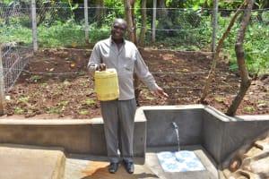 The Water Project: Shamoni Community, Shatuma Spring -  John Jumba Celebrates The Spring