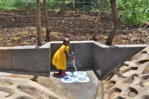 The Water Project: Shamoni Community, Shatuma Spring -  A Girl Enjoying The Water