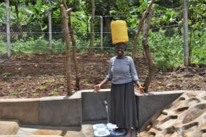 The Water Project: Shamoni Community, Shatuma Spring -  Smiling While Carrying Water From The Spring