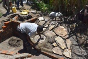 The Water Project: Bukhakunga Community, Maikuva Spring -  Stone Pitching