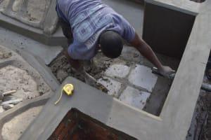The Water Project: Bukhakunga Community, Maikuva Spring -  Tile Setting