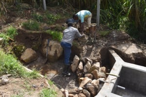 The Water Project: Bukhakunga Community, Maikuva Spring -  Backfilling With Rocks