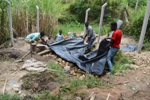 The Water Project: Bukhakunga Community, Maikuva Spring -  Backfilling With Polythene
