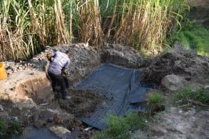 The Water Project: Bukhakunga Community, Maikuva Spring -  Slab Setting