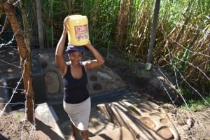 The Water Project: Bukhakunga Community, Maikuva Spring -  Carrying Water From The Spring
