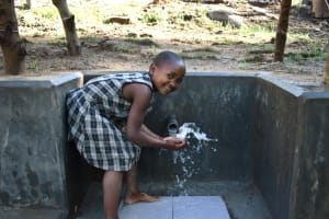 The Water Project: Bukhakunga Community, Maikuva Spring -  Gloria Enjoying Clean Water