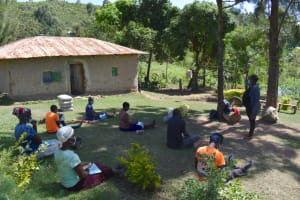 The Water Project: Bukhakunga Community, Maikuva Spring -  Participants Listen And Take Notes