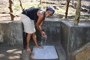 The Water Project: Bukhakunga Community, Maikuva Spring -  Woman Enjoying Water