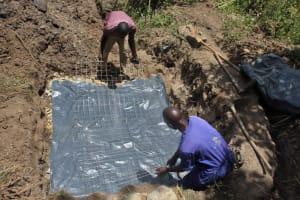 The Water Project: Litinye Community, Vuyanzi Spring -  Slab Setting