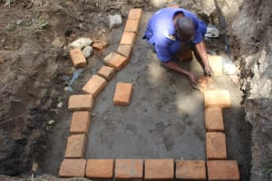The Water Project: Litinye Community, Vuyanzi Spring -  Brick Setting