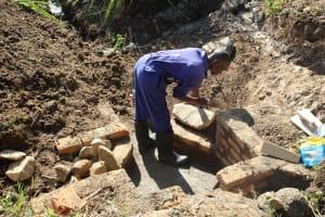 The Water Project: Litinye Community, Vuyanzi Spring -  Wall Construction