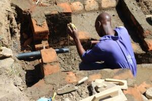 The Water Project: Litinye Community, Vuyanzi Spring -  Pipe Setting