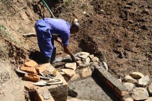 The Water Project: Litinye Community, Vuyanzi Spring -  Stone Pitching