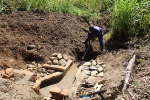 The Water Project: Litinye Community, Vuyanzi Spring -  Clearing The Drainage Channel