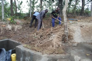 The Water Project: Litinye Community, Vuyanzi Spring -  Backfilling With Soil