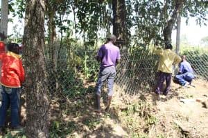 The Water Project: Litinye Community, Vuyanzi Spring -  Fencing