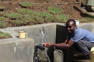 The Water Project: Litinye Community, Vuyanzi Spring -  Enjoying Water At The Spring