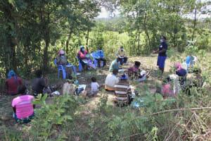 The Water Project: Litinye Community, Vuyanzi Spring -  Field Officer Betty Leads The Training