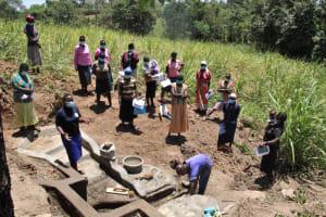 The Water Project: Litinye Community, Vuyanzi Spring -  Onsite Training On Spring Maintenance