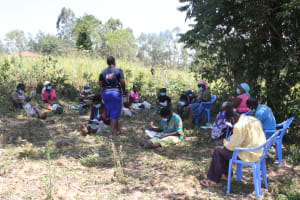 The Water Project: Litinye Community, Vuyanzi Spring -  Participants Taking Notes At Training