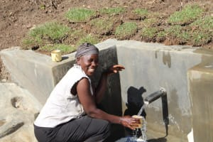The Water Project: Litinye Community, Vuyanzi Spring -  Joy At Fetching A Fresh Drink From The Spring