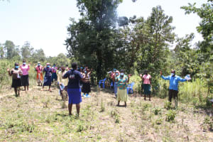 The Water Project: Litinye Community, Vuyanzi Spring -  Practicing Contactless Greetings