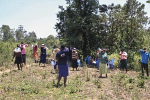 The Water Project: Litinye Community, Vuyanzi Spring -  Practicing Using The Elbow For Safer Coughs And Sneezes