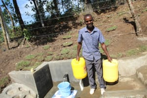 The Water Project: Litinye Community, Vuyanzi Spring -  Ready To Take Clean Water Home