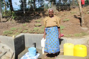 The Water Project: Litinye Community, Vuyanzi Spring -  Smiles At The Spring