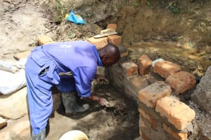 The Water Project: Mayuge Community, Ucheka Spring -  Wall Construction