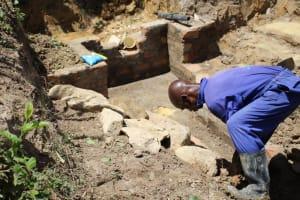 The Water Project: Mayuge Community, Ucheka Spring -  Stone Pitching