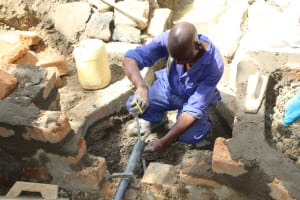 The Water Project: Mayuge Community, Ucheka Spring -  Pipe Setting