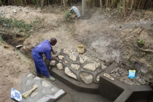 The Water Project: Mayuge Community, Ucheka Spring -  Plastering The Rub Wall