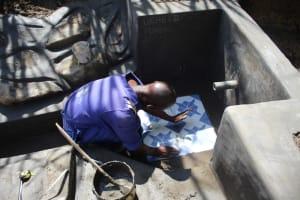 The Water Project: Mayuge Community, Ucheka Spring -  Tile Setting